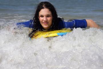 teen girl body-boarding