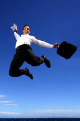 Overjoyed businessman jumping in the sky
