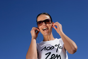 Ecstatic woman listening to her mp3 player
