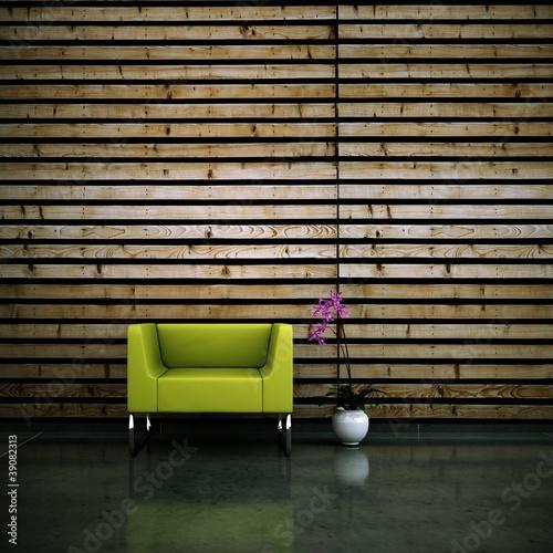 Wohndesign - Sessel grün vor Holzwand