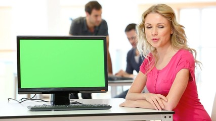 Woman presenting product on desktop computer screen