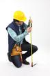 Laborer using measuring tape