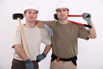 Workmen holding tools