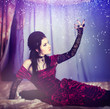 A portrait of the girl in Gothic style on a beautiful bed
