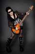 Fashion style photo of young rocked woman in studio  with guita