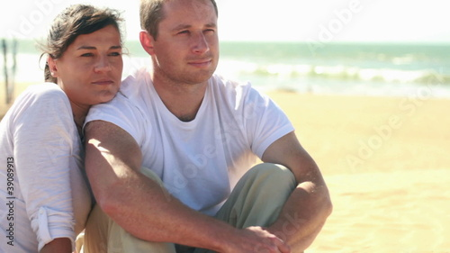 Portrait of young happy couple on the beach