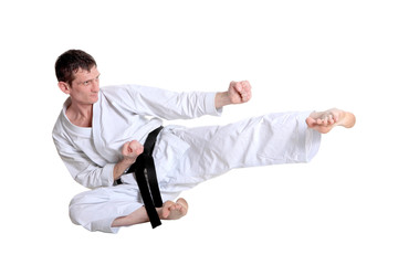 Karate jump against white background