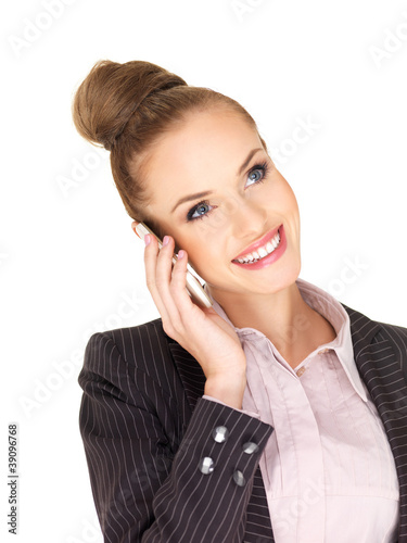 Pretty female businesswoman talking mobile phone