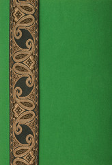 green paper background with antique ribbon
