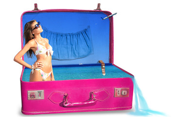 Young woman in bikini in a suitcase