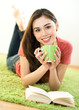 Young woman with cup and book
