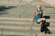 girl of a granite ladder sitting on steps