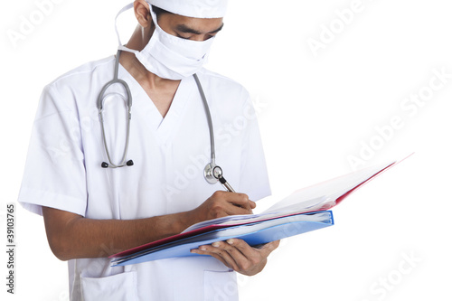 Doctor writes medical report