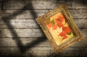quadro autunnale su parete di legno