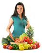 Young woman with vegetables and fruits isolated on white