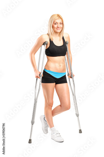 Injured young fenmale on crutches