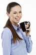 Cheerful business woman holding a cup of tea