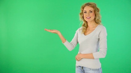 Beautiful blond girl presenting product on board