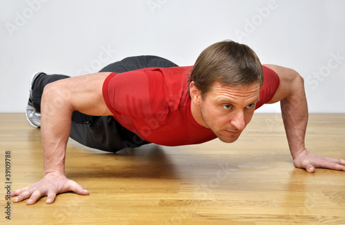 man doing pushup fitness exercise