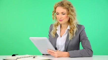 Businesswoman working on electronic tablet