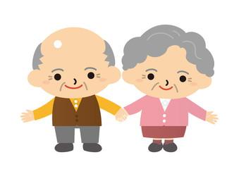 手をつないで微笑む老夫婦