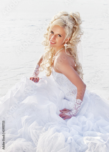 Beautiful bride in the winter forest. Beautiful blonde.