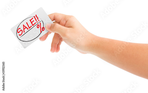 hand holding card with the word Sale