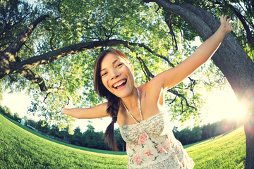 Playful summer girl in park