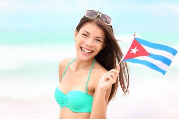 Cuba beach woman holding cuban flag