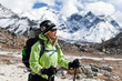 Woman trekking in Himalaya Mountains, sport and fitness outdoors