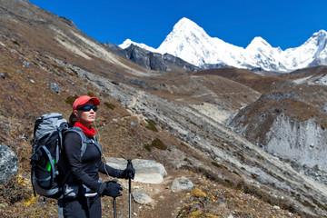 Woman trekking in Himalaya Mountains