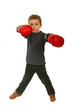 Serious boy with boxing gloves