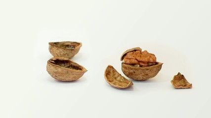 Full and empty walnuts after crack