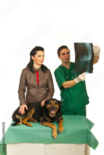 Woman with dog at vet office