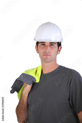 Man carrying reflective jacket over shoulder