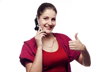 Young woman talking on the phone showing hand ok sign