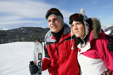 Young ski couple