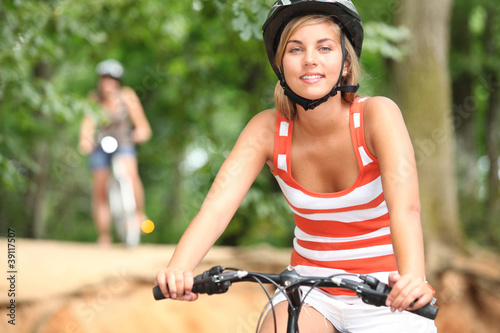 Two friend cycling in the countryside