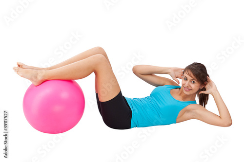 Girl exercising with fitness ball