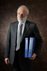 an old man hold two folders