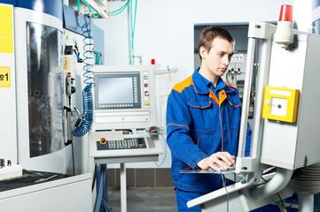 worker at machine tool in workshop