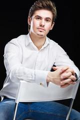 Fashion young businessman in white shirt