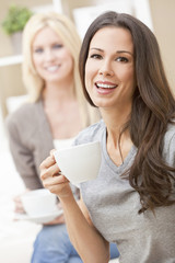 Happy Women Friends Drinking Tea or Coffee