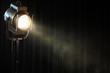 Leinwanddruck Bild - vintage theatre spot light on black curtain with smoke