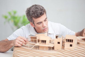 Architect working on a mock-up house