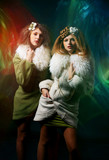 Fashion shoot of young women with fusion lighting poster