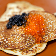 Russian traditional pancakes  with caviar