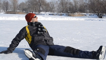 man on the ice in a city park