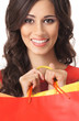 Portrait of a young brunette woman with a shopping bag