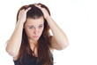 Displeased woman with hands in hair